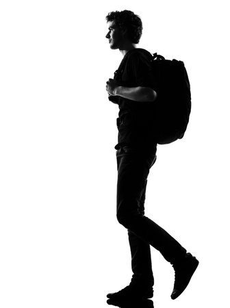 man profile: young man backpacker walking silhouette in studio isolated on white background Stock Photo