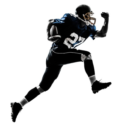 american football: one caucasian american football player man running   in silhouette studio isolated on white background Stock Photo