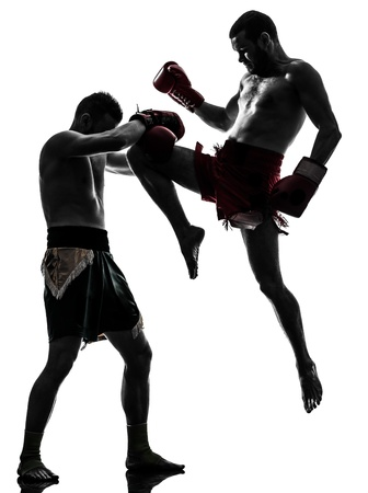 combative sport: two caucasian  men exercising thai boxing in silhouette studio  on white background