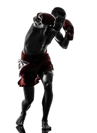 combative sport: one caucasian man exercising thai boxing in silhouette studio  on white background