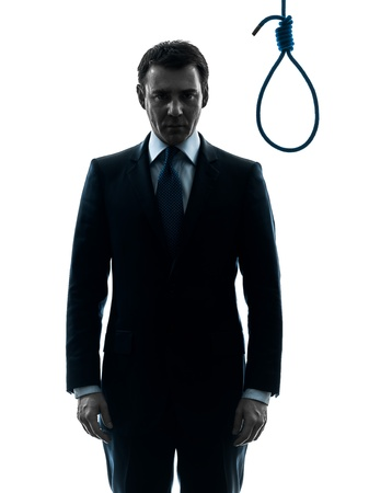 one caucasian judge  man standing in front of hangman's noose in silhouette studio isolated on white background Stock Photo - 20277675