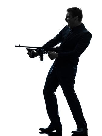 hombre disparando: un hombre caucásico celebración ametralladora thompson en silueta sobre fondo blanco