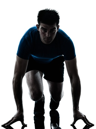 sprinting: one caucasian man runner running sprinter sprinting  in silhouette studio  isolated on white background