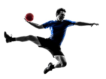one caucasian young man exercising handball player in silhouette studio  on white background photo