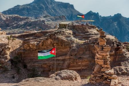 nabatean: jordan flags floating  in nabatean petra  middle east