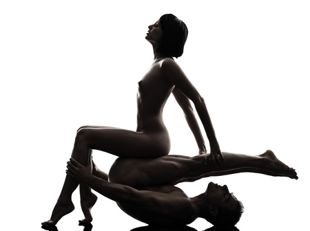 sex tenderness: one caucasian couple man woman sexual nude posture love activity  in silhouette studio on white background Stock Photo