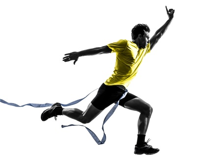 cut line: one caucasian man young sprinter runner running  winner at finish line  in silhouette studio  on white background