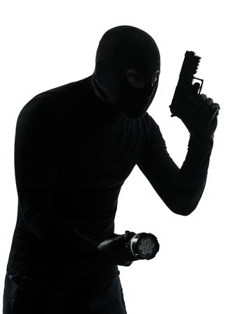 looting: thief criminal terrorist in silhouette studio isolated on white background