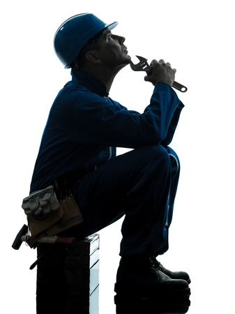 one caucasian repairman worker sad fatigue failure  silhouette in studio on white background photo