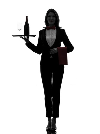 one caucasian woman waiter butler serving red wine in silhouette  on white background photo