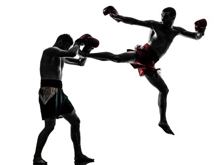 boxers: two caucasian  men exercising thai boxing in silhouette studio  on white background