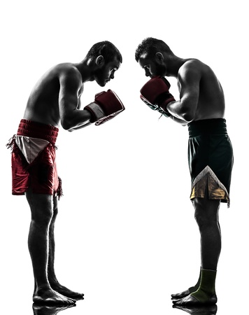 combative sport: two caucasian  men exercising thai boxing saluting in silhouette studio  on white background