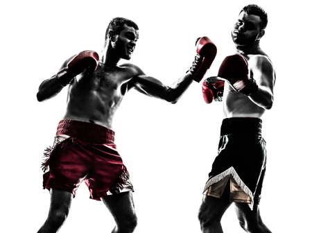 thai kick boxing: two caucasian  men exercising thai boxing in silhouette studio  on white background