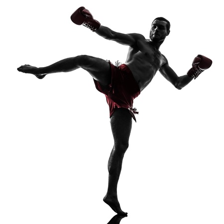 one caucasian man exercising thai boxing in silhouette studio  on white background photo