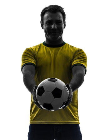 one caucasian man showing giving soccer football  in silhouette on white background photo