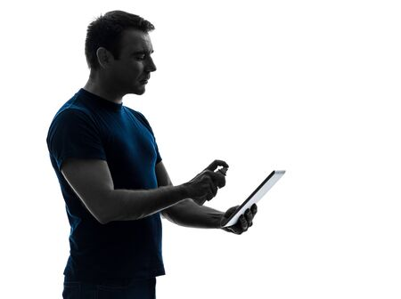 one caucasian man  cleaning dusting  digital tablet   in silhouette on white background photo