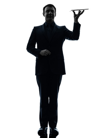 one caucasian business man holding digital tablet   in silhouette on white background photo