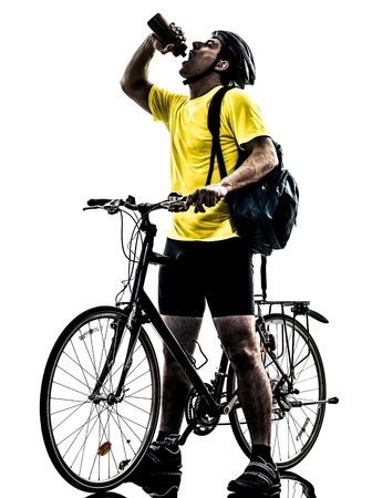 one caucasian man exercising bicycle mountain bike drinking   on white background photo