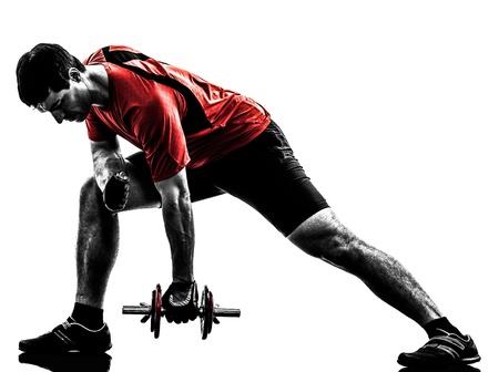 Un uomo caucasico che esercita allenamento con i pesi su sfondo bianco Archivio Fotografico - 20519460