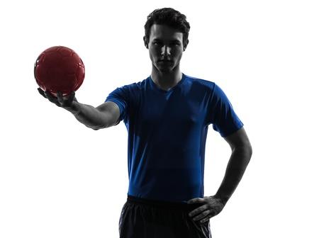 handball: one caucasian young man exercising handball player in silhouette studio  on white background