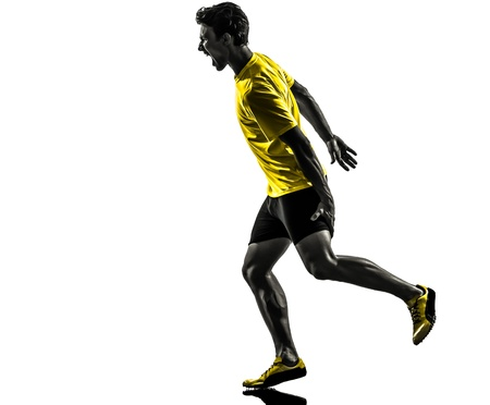 cut the competition: one caucasian man young sprinter runner running muscle strain cramp in silhouette studio  on white background Stock Photo
