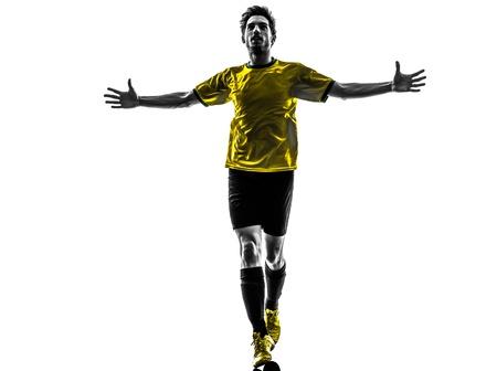 indoor soccer: una brasile?a de f?tbol jugador de f?tbol joven felicidad hombre de estudio de la silueta sobre fondo blanco