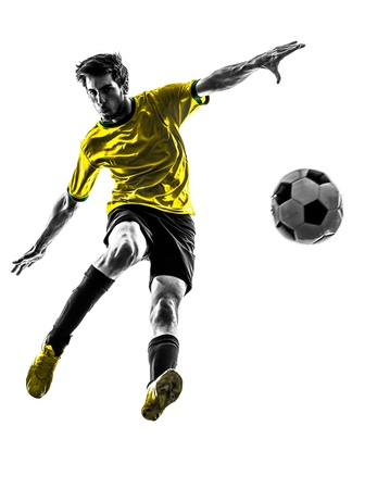 soccer player: one brazilian soccer football player young man in silhouette studio  on white background Stock Photo