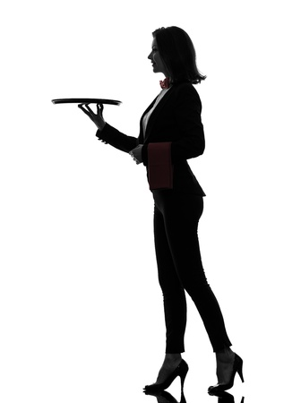one caucasian woman waiter butler holding empty tray  in silhouette  on white background photo