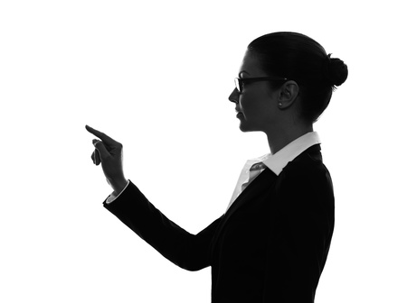 copy sapce: one caucasian business woman touching copy sapce in silhouette  on white background