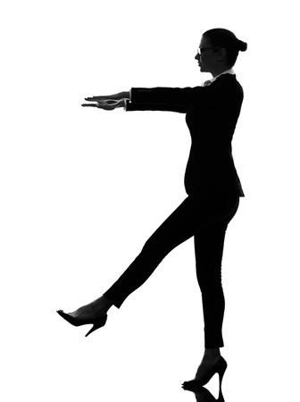 sleepwalking: one caucasian business woman sleepwalking in silhouette  on white background