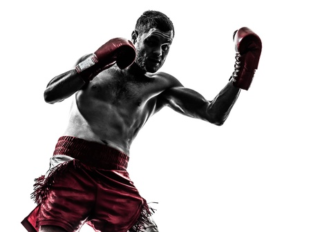 male boxer: one caucasian man exercising thai boxing in silhouette studio  on white background