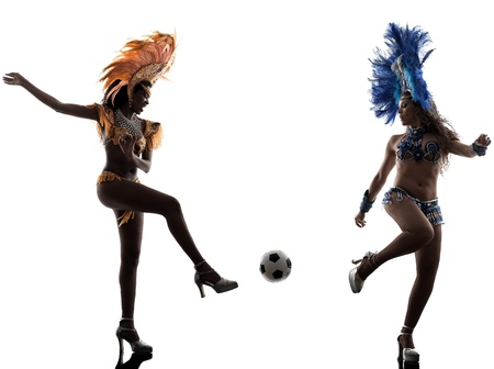 two women samba dancer  playing soccer  silhouette  on white background photo