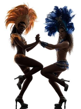 carnival background: two women samba dancer  dancing silhouette  on white background