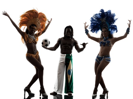 carnival costume: brazilian women samba dancer and soccer player man dancing silhouette  on white background