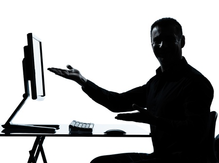 one caucasian business man showing gesture computer computing silhouette in studio isolated on white background photo