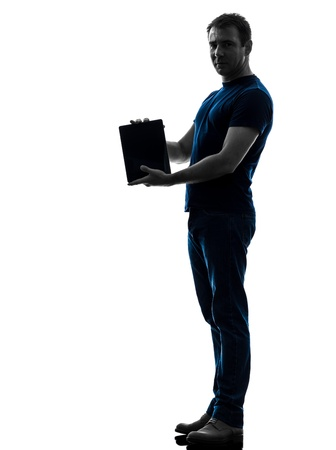 one caucasian man holding  showing digital tablet   in silhouette on white background photo