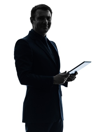 one caucasian business man holding digital tablet   posing portrait  on white background photo