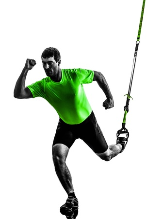 one caucasian man exercising   suspension training  trx   on white background photo