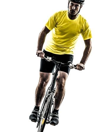 mountain biker: one caucasian man exercising bicycle mountain bike   on white background Stock Photo