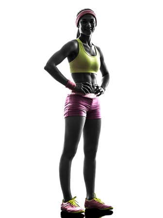 athleticism: one caucasian woman runner exercising posing    in silhouette on white background