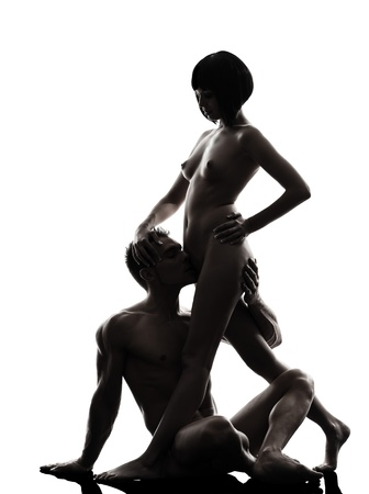 sex tenderness: one caucasian couple man woman sexual kamasutra posture love activity  in silhouette studio on white background Stock Photo