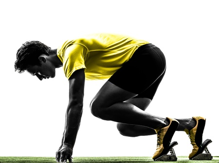 cut the competition: one caucasian man young sprinter runner  in starting blocks  silhouette studio  on white background