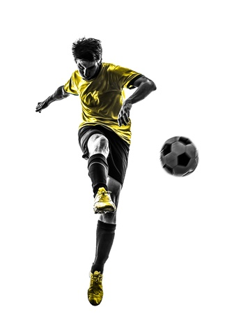 흰색 배경에 실루엣 스튜디오에서 발로 한 브라질 축구 축구 선수 젊은 남자 스톡 콘텐츠