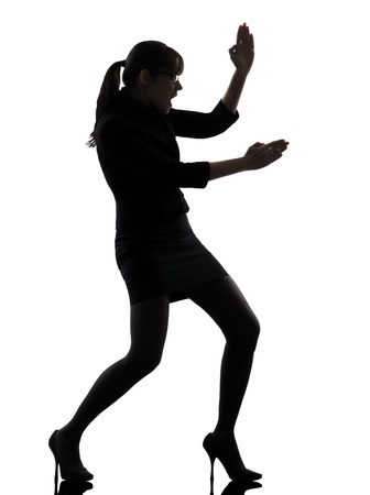 one business woman karate self defense  silhouette studio isolated on white background photo