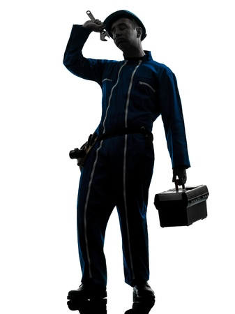 class maintenance: one caucasian repairman worker tired fatigue silhouette in studio on white background