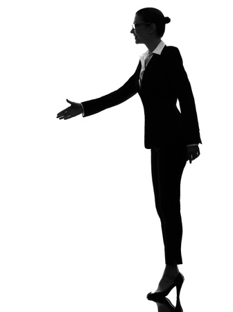 one caucasian business woman handshake  in silhouette  on white background photo