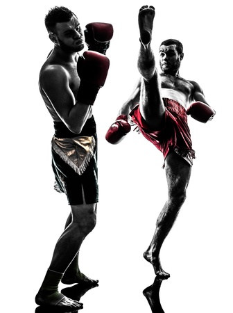 two caucasian  men exercising thai boxing in silhouette studio  on white background photo
