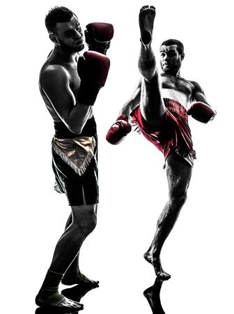 martial art: two caucasian  men exercising thai boxing in silhouette studio  on white background
