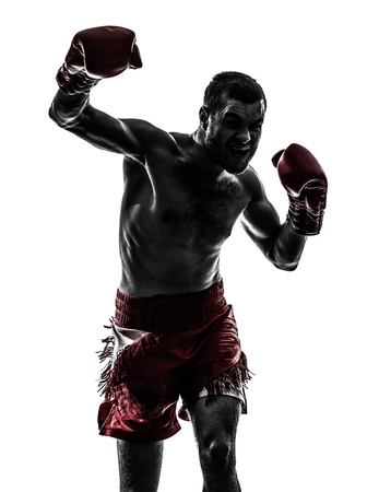 one caucasian man exercising thai boxing in silhouette studio  on white background