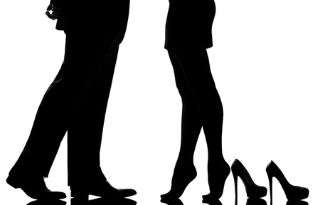 one caucasian detail legs feet couple man and woman tiptoe lovers teenderness in studio silhouette isolated on white background photo